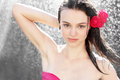 Attractive brunette woman showering outdoor Stock Photography