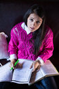 Attractive brunette woman student reading studying in her girly room portrait Royalty Free Stock Photos