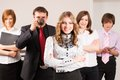 Attractive business lady and her team young with beautiful chief in office Stock Photography