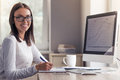 Attractive business lady in office Royalty Free Stock Photo