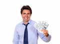 Attractive business man holding up cash dollars portrait of an against white background Stock Photos