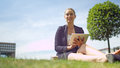 Attractive business woman relaxing with a digital tablet in the sunshine Royalty Free Stock Photo
