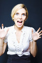 Attractive business woman screaming in terror Stock Photo