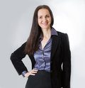 Attractive business woman smiling portrait in office beautiful young against of white Royalty Free Stock Photos
