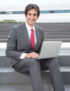 Attractive businessman with black hair and computer Royalty Free Stock Photo