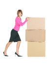 Attractive businesswoman with big boxes picture of Royalty Free Stock Images
