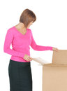 Attractive businesswoman with cardboard box picture of Royalty Free Stock Photos