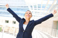 Attractive businesswoman with her arms raised an Stock Images