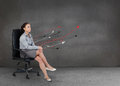 Attractive businesswoman relaxing on her chair in a grey empty room with arrows Royalty Free Stock Images