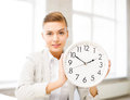 Attractive businesswoman showing white clock picture of Stock Image
