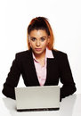 Attractive businesswoman sitting at her desk Royalty Free Stock Photo