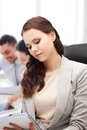 Attractive businesswoman taking notes in office Royalty Free Stock Photo