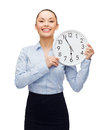Attractive businesswoman with wall clock business and time concept Royalty Free Stock Photography