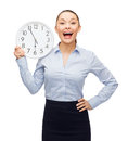 Attractive businesswoman with wall clock business and time concept Stock Images