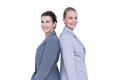 Attractive businesswomen standing back to back against white wall Stock Image