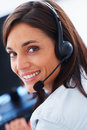 Attractive call center executive smiling Royalty Free Stock Photos