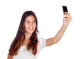 Attractive casual girl taking a photo with her mobile isolated on white background Stock Photo