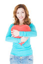 Attractive casual woman holding a baloon heart isolated on white Stock Photo