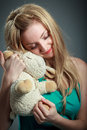 Attractive caucasian blond in years old girl isolated on a grey background Royalty Free Stock Images