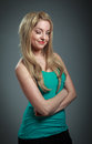 Attractive caucasian blond in years old girl isolated on a grey background Royalty Free Stock Photos