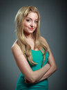 Attractive caucasian blond in years old girl isolated on a grey background Royalty Free Stock Photo