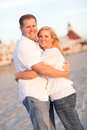 Attractive Caucasian Couple Hugging at the Beach Royalty Free Stock Photo