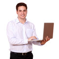 Attractive caucasian guy using his laptop portrait of an while standing and looking at you on isolated studio Stock Images