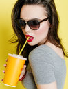 Attractive Caucasian woman with a paper cup of juice. Royalty Free Stock Photo