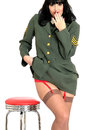 Attractive Cheeky Sexy Young Vintage Pin Up Model In Military Uniform With Suspender Belt and Stockings Royalty Free Stock Photo