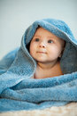 Attractive child in blue towel Royalty Free Stock Images