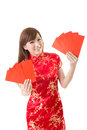 Attractive chinese woman dress traditional cheongsam and hold red envelope closeup portrait on white background Stock Image