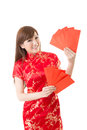 Attractive chinese woman dress traditional cheongsam and hold red envelope closeup portrait on white background Stock Photos