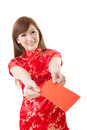 Attractive chinese woman dress traditional cheongsam and hold red envelope closeup portrait on white background Stock Photography