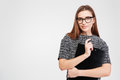 Attractive confident businesswoman in glasses with clipboard and pen Royalty Free Stock Photo