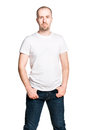 Attractive confident man in white t shirt and blue jeans vertical portrait of an isolated on Stock Images