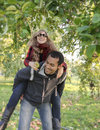 Attractive couple apple picking on a first date young urban multiethnic ages late teens early s young man has young woman his Stock Photo