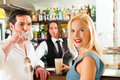 Attractive couple in cafe or coffeeshop Royalty Free Stock Photography
