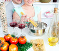 Attractive couple cooking spaghetti in the kitchen Royalty Free Stock Photo