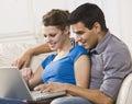Attractive couple laptop together working Στοκ εικόνα με δικαίωμα ελεύθερης χρήσης