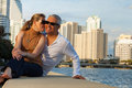 Attractive couple middle age outdoors in a downtown urban bay setting Royalty Free Stock Photo