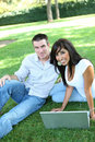 Attractive Couple in Park with Laptop Stock Photos