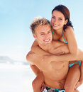An attractive couple piggybacking in outdoors Royalty Free Stock Photo