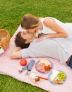 Attractive couple on romantic afternoon picnic kissing Royalty Free Stock Photo