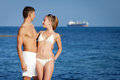 Attractive couple at the sea young men and women on seashore in day time Royalty Free Stock Photos