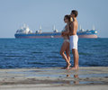 Attractive couple at the sea young men and women on seashore in day time Stock Images