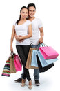 Attractive couple with shopping bag Royalty Free Stock Photo