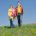 Attractive couple walking along the field Stock Photos