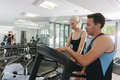 Attractive couple working out in gym Stock Image