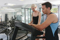 Attractive couple working out in gym Stock Images