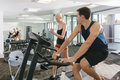 Attractive couple working out in gym Royalty Free Stock Image